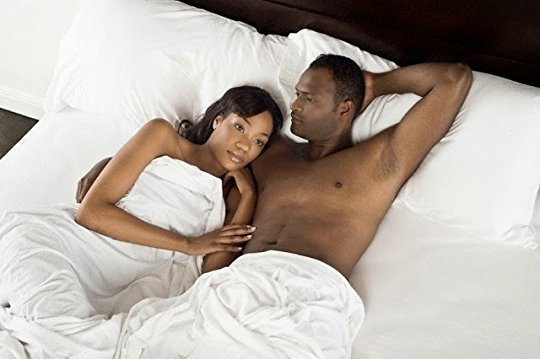 Man and woman in bed