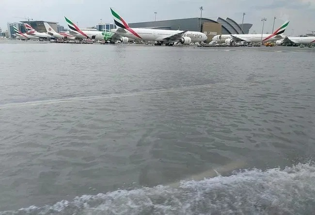 A flooded Dubai International Airport: runway submerged