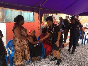 Police Officers sharing their condolences with family of their deceased colleague