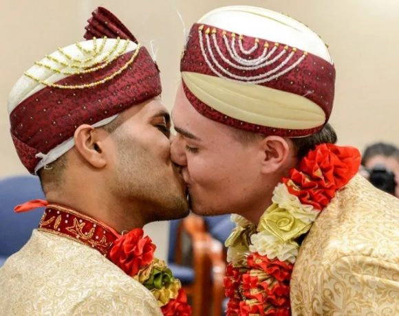 Jahed Choudhury and Sean Rogan kiss after getting married in Walsal
