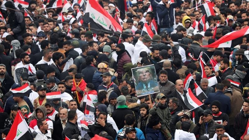 Supporters of Iraqi Shia Muslim leader Muqtada al-Sadr protest against what they say is US presence and violations in Iraq [Thaier al-Sudani/Reuters]