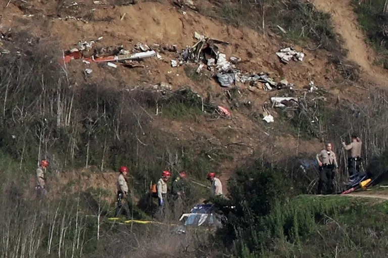 Sheriffs and officials investigate the helicopter crash site of NBA star Kobe Bryant in Calabasas, California (Picture: Reuters)