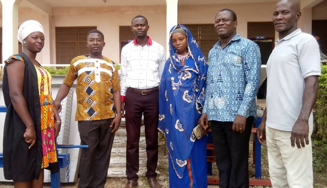 DCE for Asutifi North(third from left to right) and NBSSI Regional Manager, Kwesi Abayie Acheampong(second from right to left) with some beneficiaries.