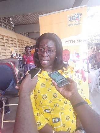 Madam Adwoa Baah Obeng Afrakoma, Acting General Manager of MTN speaking to the media during the medical screening exercise at the Kumasi Technical Institute in Kumasi