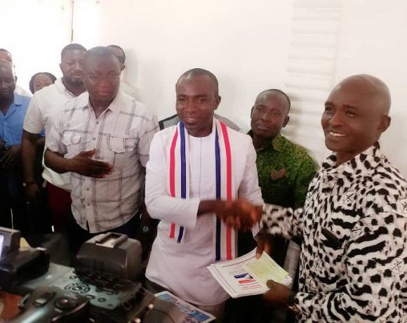 Hon Kennedy Kwasi Kankam, MP for Nhyiaeso presenting his nomination forms to Chairman George Kofi Adjei (Geokad) at the party's office at Santasi