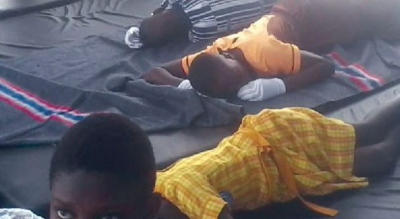 Some schoolchildren who collapsed during the the maiden Greater Accra Regional Independence Day celebration held at the Tema Stadium awaiting treatment