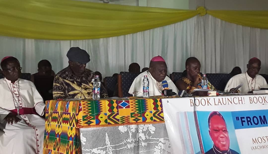"""Most Rev Dr Peter Kwasi Sarpong, Archbishop Emeritus of the Catholic Archdiocese of Kumasi speaking at the launch of his autobiography titled """"From the Hut to Oxford"""" last Thursday. Seated next to him are Mr J.A Kufuor, Former President of Ghana and Nana Otuo Siriboe II, Chairman of the Council of State and Omanhene of the Juaben Tradional Council."""