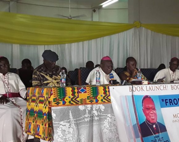 "Most Rev Dr Peter Kwasi Sarpong, Archbishop Emeritus of the Catholic Archdiocese of Kumasi speaking at the launch of his autobiography titled ""From the Hut to Oxford"" last Thursday. Seated next to him are Mr J.A Kufuor, Former President of Ghana and Nana Otuo Siriboe II, Chairman of the Council of State and Omanhene of the Juaben Tradional Council."