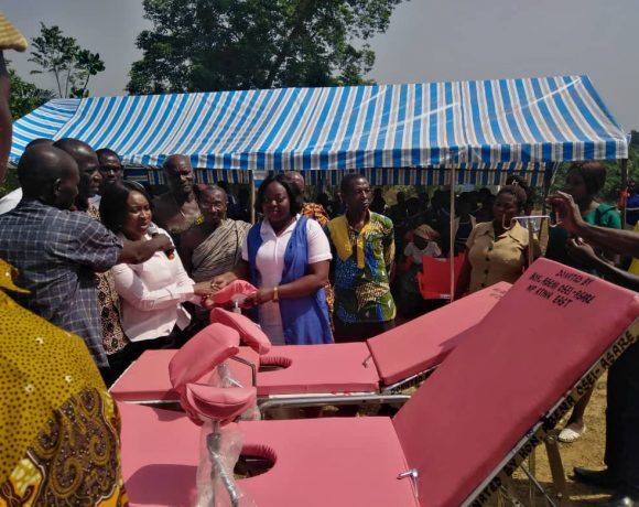 Hon Abena Osei-Asare, MP for Atiwa East and Deputy Finance minister presenting some of the beds to one of the facilities within the constituency.